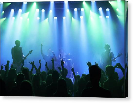 Enjoying Every Song The Band Plays Canvas Print by Yuri arcurs