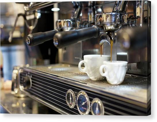 Espresso Machine Pouring Coffee Into Canvas Print by Kathrin Ziegler