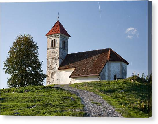 Evening Glow Over Church Canvas Print