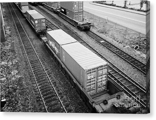 Freight Trains Canvas Print - evergreen and tex freight shipping containers on rail cars freight train goods tracks Vancouver BC C by Joe Fox