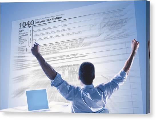 Excited Man And Income Tax Form Canvas Print by Comstock