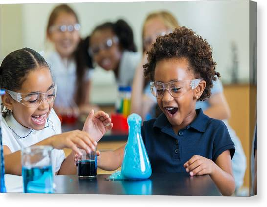 Excited School Girls During Chemistry Experiment Canvas Print by Steve Debenport