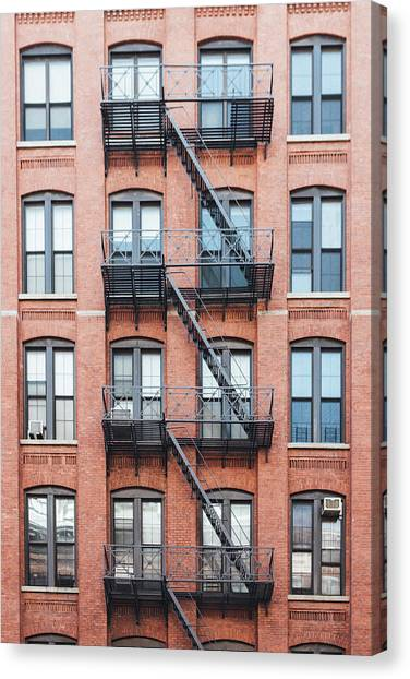 Exterior Of Buildings In New York City Canvas Print by Deimagine