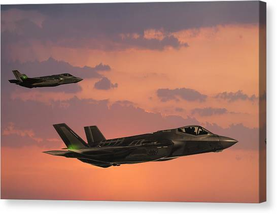 F-35 Fıghter Jets In Flight At Sunset Canvas Print by Guvendemir