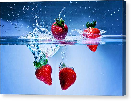 Falling Strawberries Canvas Print