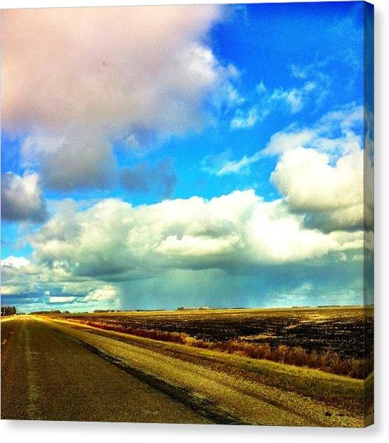 Manitoba Canvas Print - Far Away Storm #storm #driving #clouds by Kelsey Parisien