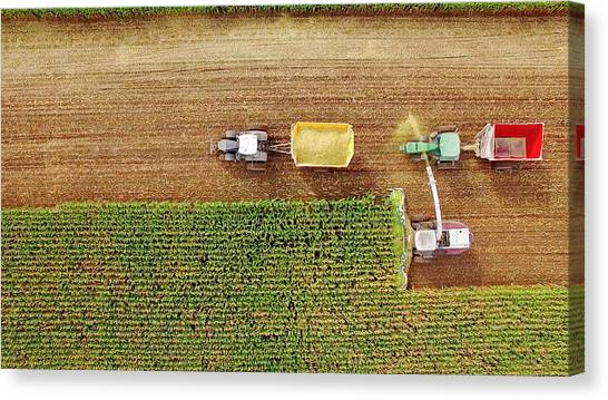 Farm Machines Harvesting Corn In September, Viewed From Above Canvas Print by JamesBrey