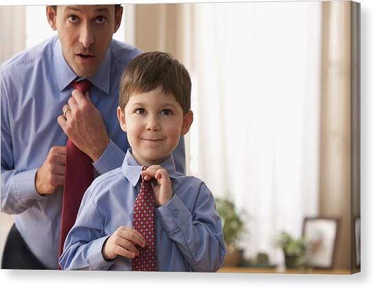 Father And Son Fixing Ties Together Canvas Print by SelectStock