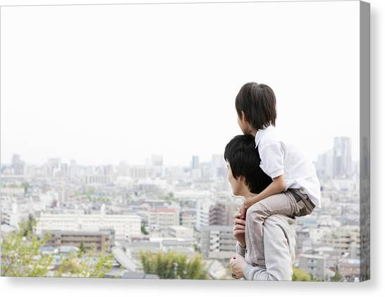 Father And Son On A Hill Canvas Print by Kohei Hara