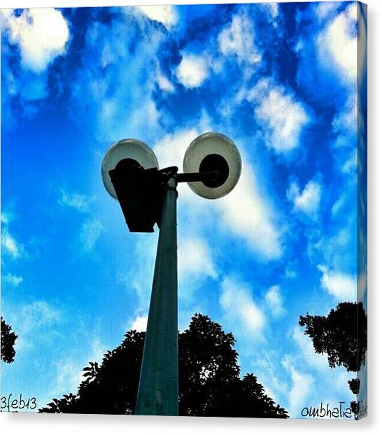 Om Canvas Print - Feeling Blue? #lamppost #sky #skylover by Om Bhatia