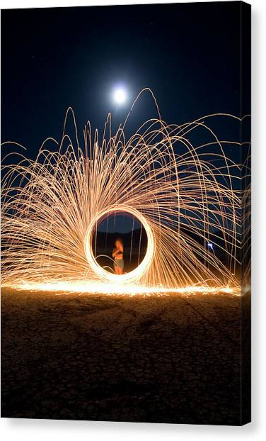 Black Rock Desert Canvas Print - Female Adult Spinning Fire With A Full by Ian Austin