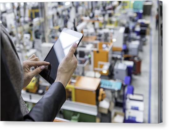 Female Manager Working On Tablet In Factory Canvas Print by Yoh4nn