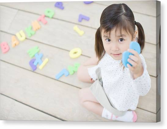Female Toddler Playing With Educational Toys Canvas Print by Image Source