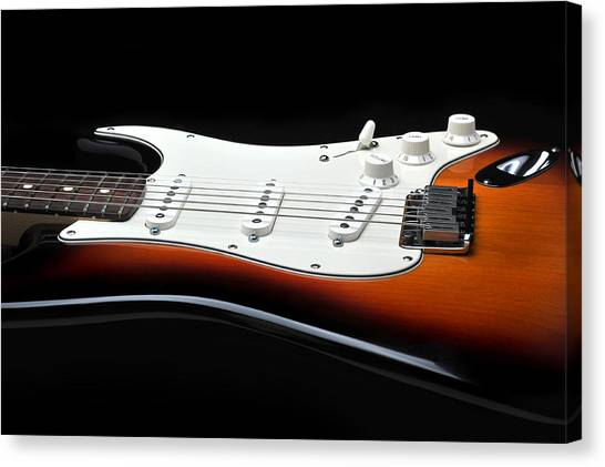 Fender Stratocaster Guitar On Black Background Canvas Print