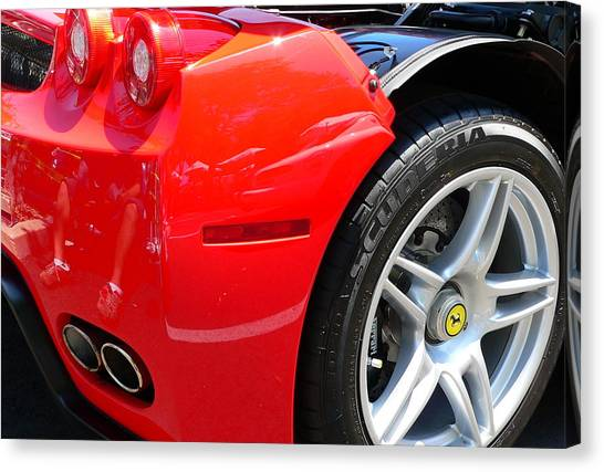 Canvas Print featuring the photograph Ferrari Rear Panel And Tire by Jeff Lowe