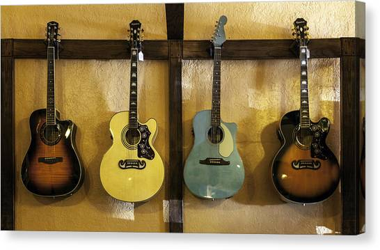 Festive Acoustic Guitars All In A Row Canvas Print
