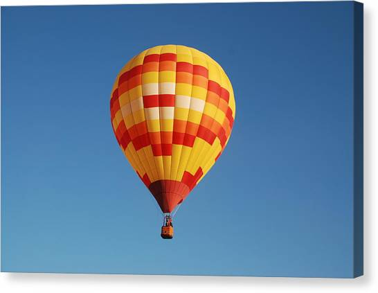 Fiery Balloon Canvas Print by Miguelito B