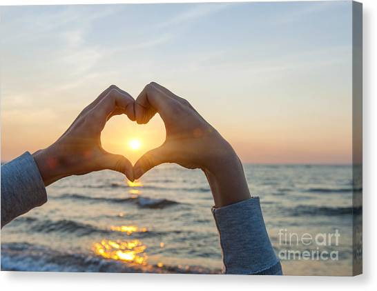 Sunrise Canvas Print - Fingers Heart Framing Ocean Sunset by Elena Elisseeva