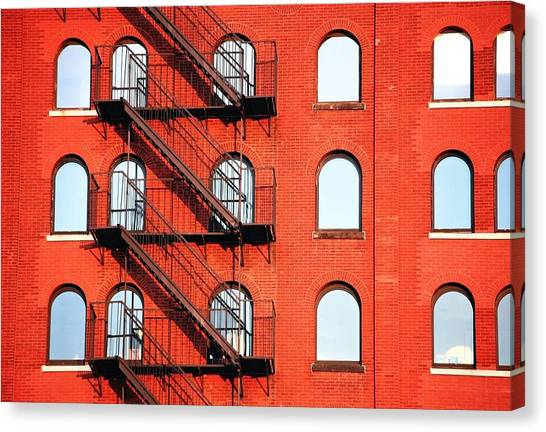 Fire Escape Of Red Building Canvas Print by Travis Chambers / Eyeem