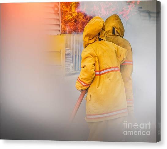 Volunteer Firefighter Canvas Print - Firefighter  by Anek Suwannaphoom