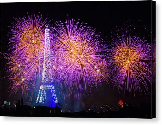 Eiffel Tower Canvas Print - Fireworks At The Eiffel Tower For The 14 July Celebration by Laurent Lothare Dambreville