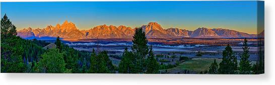 Canvas Print featuring the photograph First Light On The Tetons by Greg Norrell
