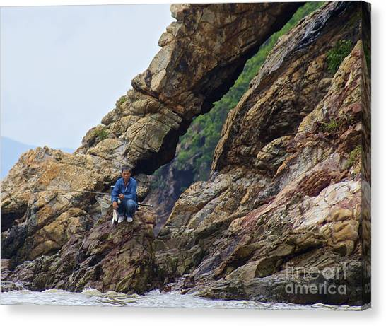 Fisherman On Rocks  Canvas Print