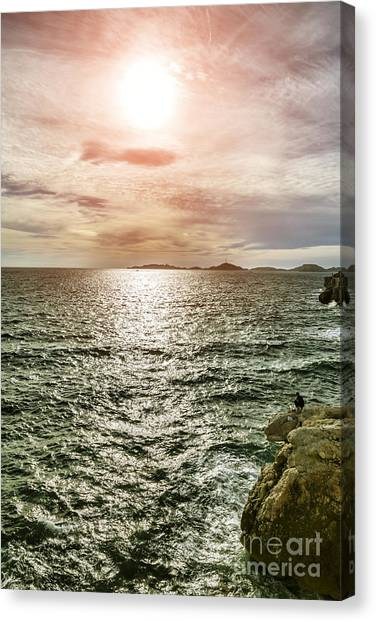 Fisherman On The Cliff At Sunset Canvas Print by Pier Giorgio Mariani