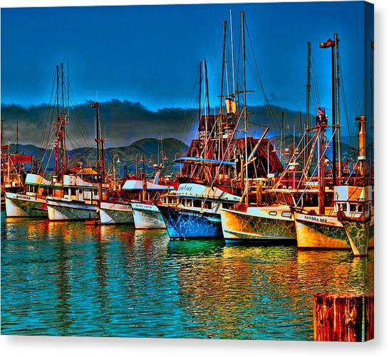Canvas Print featuring the photograph Fishing Fleet At Suns Setting by William Havle