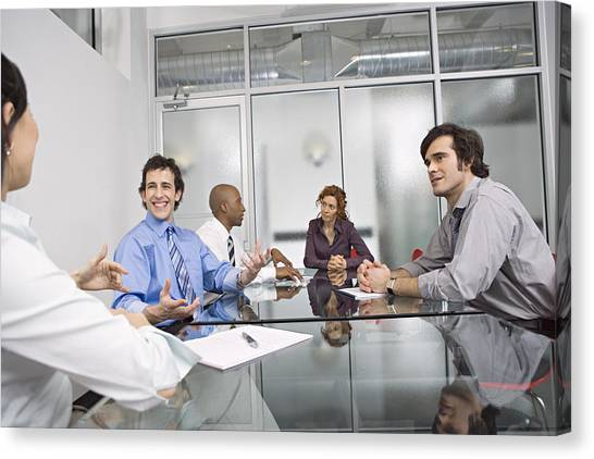 Five Businesspeople Sitting At Conference Table, Discussing Canvas Print by Bob Handelman