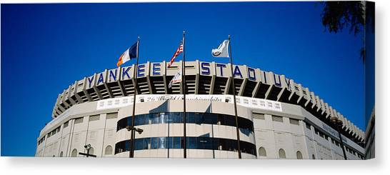 Yankee Stadium Canvas Print - Flags In Front Of A Stadium, Yankee by Panoramic Images
