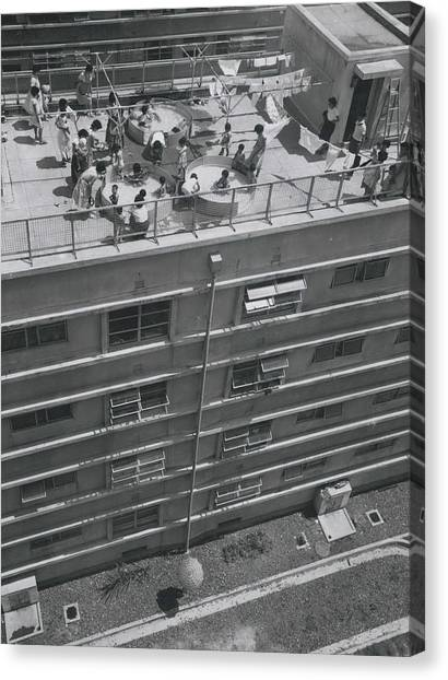 Flat Dwelliers Club Together To Buy Kids Roof Top Swimming Canvas Print by Retro Images Archive