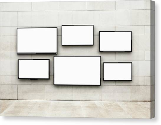 Flat Screens Hanging On A Wall Canvas Print by Jorg Greuel
