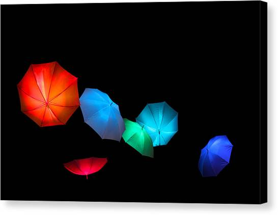 Floating Umbrellas  Canvas Print by James Hammen