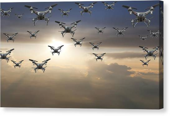 Flock Of Drones In The Sky At Sunset Canvas Print by Buena Vista Images