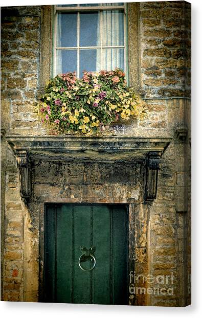 Charming Cottage Canvas Print - Flowers Over Doorway by Jill Battaglia