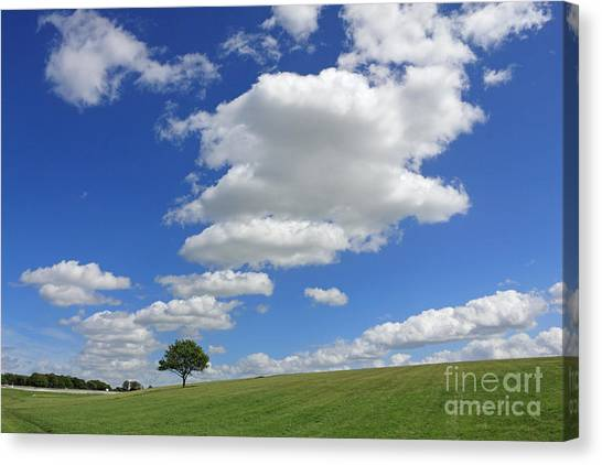 Fluffy Clouds Over Epsom Downs Surrey Canvas Print