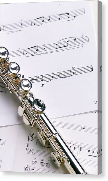 Brass Instruments Canvas Print - Flute On Music by Jon Neidert