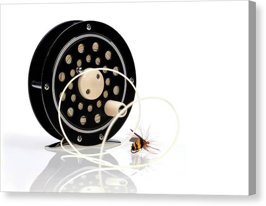 Spiral Canvas Print - Fly Fishing Reel With Fly by Tom Mc Nemar