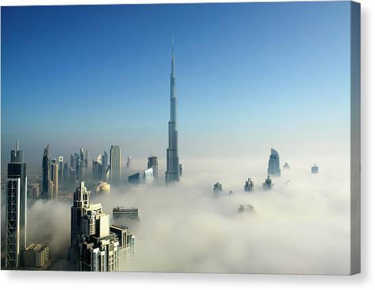 Fog In Dubai Canvas Print by © Naufal Mq