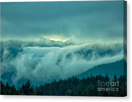 Fog Rolling Over The Montana Rocky Mountains Canvas Print by Natural Focal Point Photography