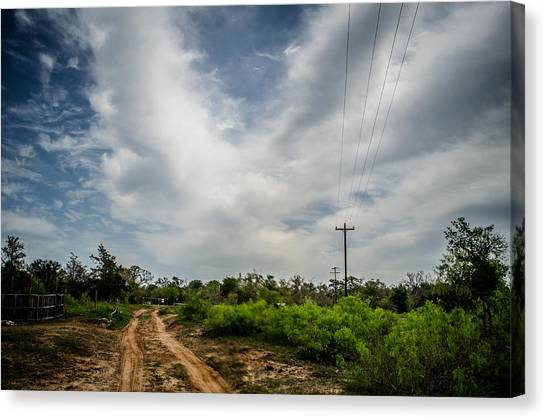 Follow The Dirt Road Home Canvas Print by Kelly Kitchens