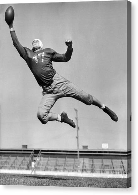 Football Canvas Print - Football Player Catching Pass by Underwood Archives