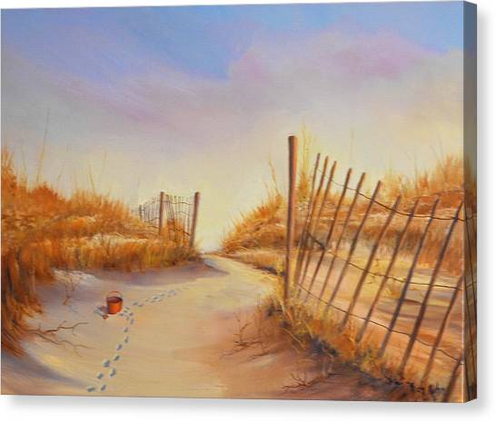 Forgotten Toy In The Sand Canvas Print by Rich Kuhn
