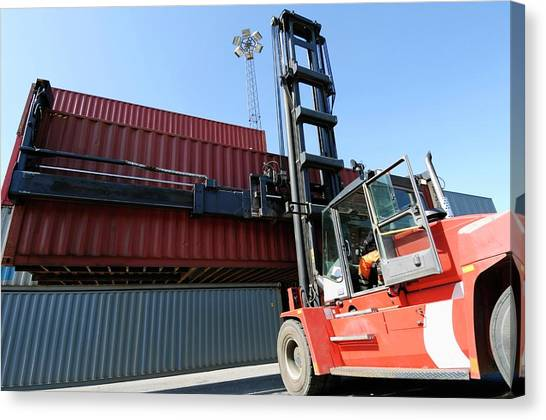 Forklifts Canvas Print - Forklift Truck Lifting Shipping Container by Christian Lagerek/science Photo Library