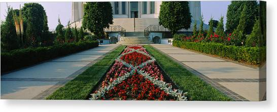 House Of Worship Canvas Print - Formal Garden In Front Of A Temple by Panoramic Images