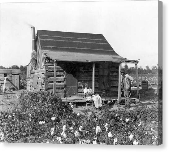 Racism Canvas Print - Former Slaves At Their Cabin by Underwood Archives