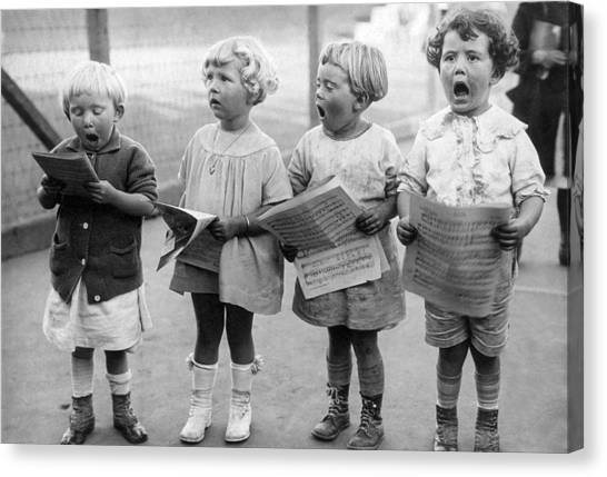 Four Young Children Singing Canvas Print