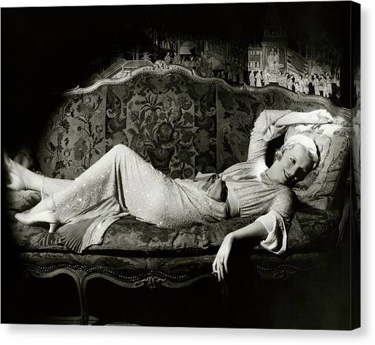 Frances Willams Lying On A Couch Canvas Print by Cecil Beaton