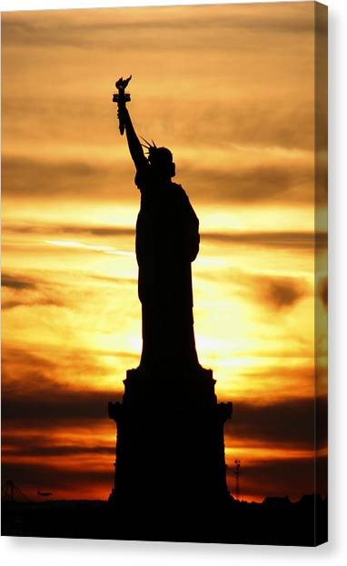 Canvas Print featuring the photograph Statue Of Liberty Silhouette by Bob Slitzan